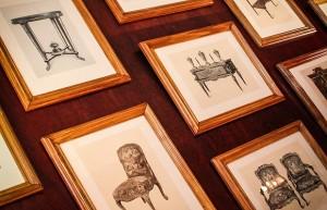 Muitos quadros foram colocados nas paredes e a inspiração dos desenhos não poderia ser mais charmosa: móveis antigos (Foto: Divulgação)